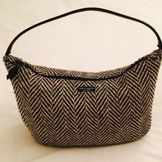 Kate Spade vintage wool tweed herringbone bag This is a unique and beautiful vintage Kate Spade bag. Ive had it for many years but haven't used it much as you can see from the photos. It's in excellent condition inside and out. Even the strap is flawless  kate spade Bags Shoulder Bags