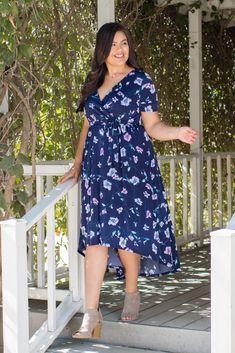 89f25be1d09 Floral print plus wrap dress. Hi-low hemline. Sash tie. Short sleeves