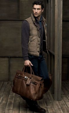 Tan Cashmere Puffer Vest, Charcoal Grey Cashmere Sweater, Pinwale Corduroy Jeans, and Vintage Hermes Travel Bag, by Bruno Cuccinelli. Men's Fall Winter Fashion.