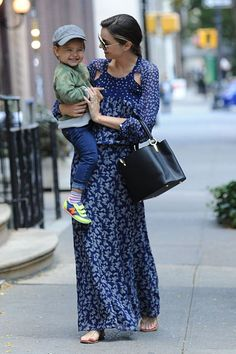 Pin for Later: Miranda Kerr Has an Outfit For Just About Everything  Miranda took Flynn (and her Capucines bag!) out again for a spin, this time in a blue printed maxi dress and sandals.