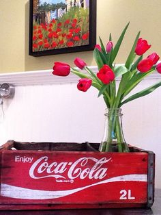 coca-cola crate with beautiful flowers