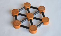 Vintage Nissen (of) Denmark Hexagon Wooden Trivet. $10.00, via Etsy.
