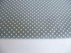 29. Mini polka dots on dark grey