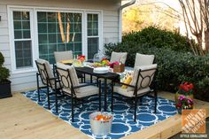 Kelly, of the View Along the Way blog, shows how she gave her small patio a fresh, colorful start. Click to see Kelly's very practical small patio decorating ideas.