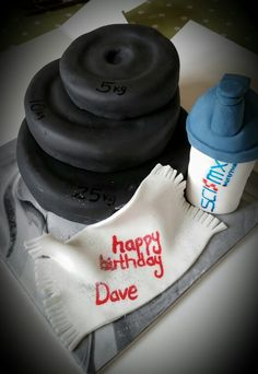 Weightlifting cake with protein bottle