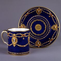 A Sèvres Porcelain 'Jewelled' Cup & Saucer, circa 1785, Portraits by Etienne-Henry Le Guay of Louis XVl, Marie-Antoinette, Frederick the Great & his consort and of Benjamin Franklin.