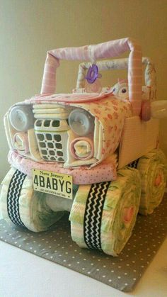 Baby diaper cake shaped like a Jeep... love it.