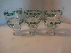 Vintage Set of Ivy Retro Juice Glasses.  Fresh retro look for your morning juice, or beverage.  A set of six footed glasses has green ivy dancing around the top of each glass.  These glasses measure 3