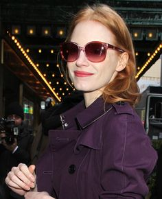 Jessica Chastain wears a purple trench coat outside the Walter Kerr Theatre for her Broadway play 'The Heiress' in New York City on January 2, 2013