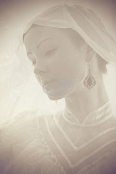 Ghostly image of beautiful young caucasian woman in retro style