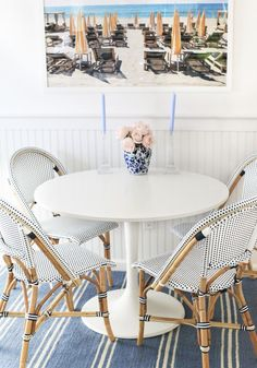 Cosy and pretty breakfast table with cafe chairs and summer inspired artwork Cafe Tables, Table And Chairs, Knoll Table, Dinner Chairs, White Round Dining Table, Dining Tables, Bistro Chairs, Bars For Home, House Design