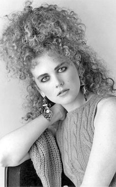 I bet she wishes she could re-think her hairdo choice for that photo shoot. [Nicole Kidman, 1987. Photo by Newspix/Getty Images. ]