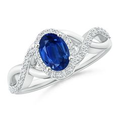 Featuring an intriguing design crafted in 14k white gold, this sapphire halo ring will add just the right amount of sparkle to your ensemble. Oval Blue Sapphire Crossover Ring with Diamond Halo
