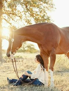 A beautiful image showing the relationship between a horse and a girl.