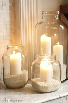 For the bathroom. Recycled glass jars & white candles! Love the sand.