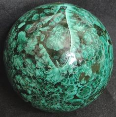 Lovely polished malachite mineral sphere.