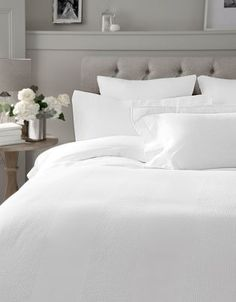 If this isn't a perfect bed set-up, then we're not sure what is. Sleep away all your problems in crisp, white bed sheets.