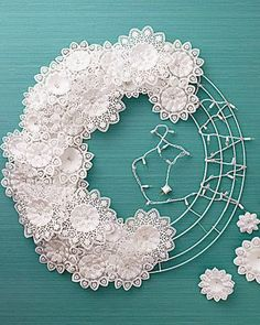 DIY- wreath made with paper doilies and a string of white lights. from Martha Stewart Wreath Crafts, Diy Wreath, Paper Crafts, Diy Crafts, Snowflake Wreath, Diy Paper, Paper Snowflakes, Wreath Ideas, Tulle Wreath Tutorial
