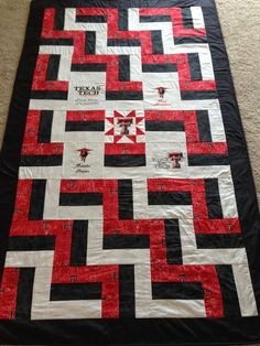 Made this XL Twin Texas Tech college quilt for my nephew.  The 5 middle squares where machine embroidered.