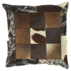 """Crafted from cowhide and showcasing a patchwork motif, this eye-catching pillow adds a striking touch to your favorite chaise or arm chair.  Product: PillowConstruction Material: Leather cover and polyester fillColor: Espresso, brown, ecru and blackFeatures: HandcraftedPatchwork motifInsert includedZipper closureMade in IndiaDimensions: 18"""" x 18""""Cleaning and Care: With a dry cotton towel or white paper towel, blot out stain as much as possible. Scrape off any debris. Test fabric cleaner in…"""