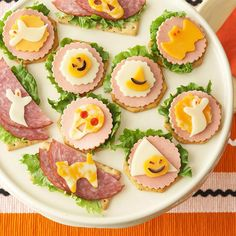 For a horrifyingly delicious Halloween party recipe, use mini Halloween-theme cookie cutters to cut out pieces of cheese and meat. Place the creepy cutouts on top of your favorite crackers and accent with leaves of dark green lettuce. Small black olive pieces easily embellish these creative crackers./