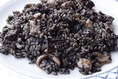 Arros Negre. When in Barcelona you must try the typical Catalan/Valencian dish of Arros Negre- Black Rice.    The dish's dark color comes from squid ink which also enhances its seafood flavor.