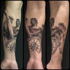 Angel statue clock tattoo