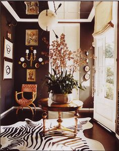 Look at the orchid on this foyer table! The dark floor, dark walls. Zebra Cowhide Rug, the glass doo Black Painted Walls, Dark Walls, Vogue Living, Futuristic Furniture, Decorating Small Spaces, Black Decor, Rugs In Living Room, Interior Design Living Room, Interior Livingroom