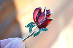 Enamel and rhinestone red rose brooch.  Is there anything more romantic?