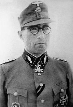 "Waffen SS Brigadefuhrer August Schmidhuber- Commands held-SS-Freiwilligen-Gebirgsjäger-Regiment 14 ""Skanderberg"",21st Waffen Mountain Division of the SS Skanderbeg (1st Albanian),7th SS Volunteer Mountain Division ""Prinz Eugen""-Awards German Cross in Gold-SS-Brigadeführer of the 7th SS Volunteer Mountain Division ""Prinz Eugen"" from 20 January 1944 to 8 May 1945, and the 21st Waffen Mountain Division of the SS Skanderbeg (1st Albanian) from May 1944 onwards."