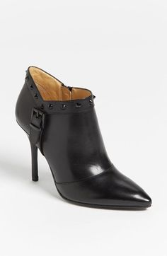 Anniversary Sale! An almond-shaped toe echoes the pointed studs encircling an edgy blackout boot perched on a femme heel. Color(s): black. Brand: Enzo Angiolini. Style Name: Enzo Angiolini 'Presley' Boot