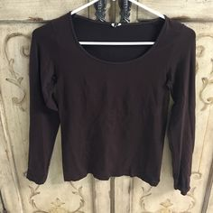 Brown Long Sleeve Shirt Tag was cut out because it was itchy. Soft and stretchy chocolate brown long sleeve scoop neck shirt. Tops Tees - Long Sleeve