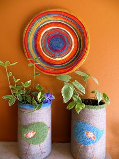Wrap scraps of yarn on the face of a paper plate, gluing down as you go, to create a colorful wall hanging.