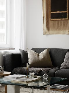 Cozy Scandinaian living room with dark details. Styled by Josefin Hååg photographed by Krisofer Johnsson
