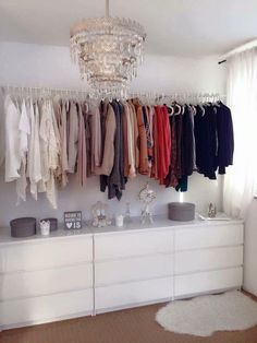 Spare bed room divide it with IKEA 20 slot shelving unit and make a closet on one wall: