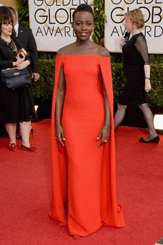 Lupita Nyong'o — Wow, right? Nyong'o has been absolutely dominating the red carpet recently, and this blood-orange, caped Ralph Lauren gown was truly next-level. It's red carpet in the front, Liberace in the back!
