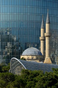 Shahidlar Mosque next to Flame Towers, Baku, Azerbaijan.