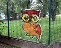 Cross-Stitch Murals on Chain Link Fences