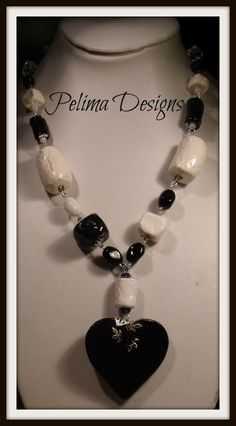 Chunky black and white necklace made with my own clay beads that have been fired and then glazed and fired again. Finished with glass beads and crystals.