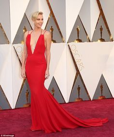 Charlize Theron ripped up the rule book by wearing red on the red carpet and her Dior crea...