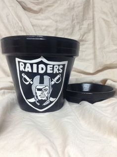 2d1504ae48c7 Hand painted Oakland Raiders flowerpot. We can paint any team! Carolina  Panthers. Tennessee Titans. Jacksonville Jaguars. Detroit Lions.