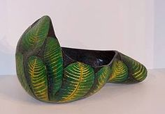 """Carved Leaf Bowl  by Karen Hundt-Brown  This large green leaf bowl is cut from a single Kettle gourd, laid on it's side with an asymmetrical opening. Size: 15""""L x 11.5""""W Price: $130.00  On Artful Vision, www.artfulvision.com a portion of your purchase is donated to a participating non-profit of your choice. #art #bowl #Green #home #decor #design #gift"""