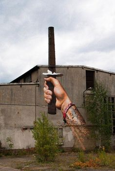 Street Art - Use what is there. Freedom Fighter. Tattooed wrist holding sword.