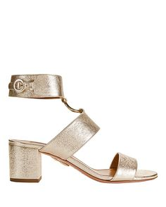 Aquazzura Safari Metallic Sandals: A 50mm block heel lifts these metallic sandals. Two straps at vamp and buckled ankle cuff. Open ring detail. Leather soles. In gold-tone. Made in ...