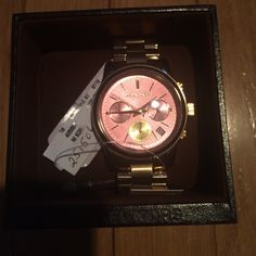 Michael Kors Rose Gold watch. Hard to find, rose gold with pink face. New in box! Never worn. Tags still attached. Michael Kors Accessories Watches