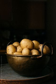 Brass bowl with potatoes