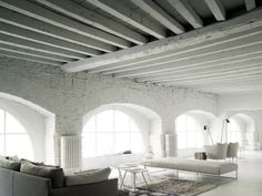 Boffi showroom in Milan on Via Solferino. A spectacular space with Living Divani upholstery fleshing out the rooms.
