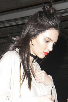 Copy Kendall Jenner's courtside style at last night's Lakers game on your next low-key date night. The messy half knot says you don't spend a lot of time in front of the mirror, while the flame-red lipstick screams most confident girl in the arena.