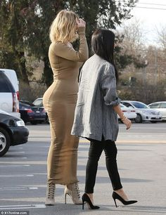 Oh dear: Khloe decided to transform a day out into a glamorous affair, but it did not go quite to plan with her gold dress going sheer in the sunlight
