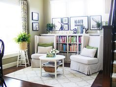 Use bookcases behind chairs in master bedroom sitting area.